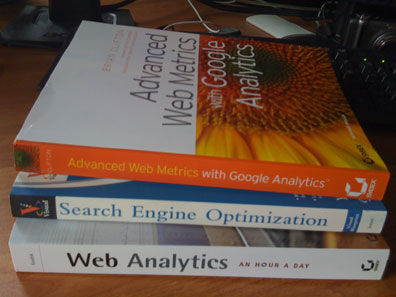 screen shot of a stack of books about google analytics and search engine optimization